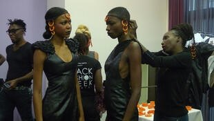 Adama Ndiye (right) prepares her models before the show