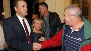 Victorious Front National party candidate Laurent Lopez (L)