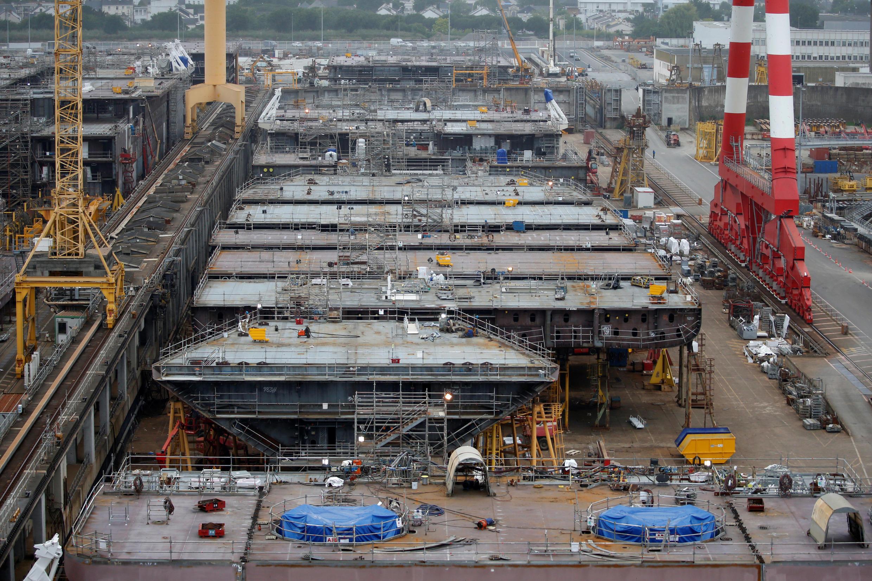 Shipbuilders work on the MSC Grandiosa cruise ship at the STX shipyard site in Saint-Nazaire, France, June 14, 2018.