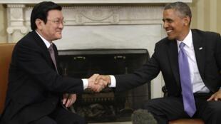 Chủ tịch nước Việt Nam Trương Tấn Sang (trái) và Tổng thống Hoa Kỳ Barack Obama tại Nhà Trắng ngày 25/07/2013.