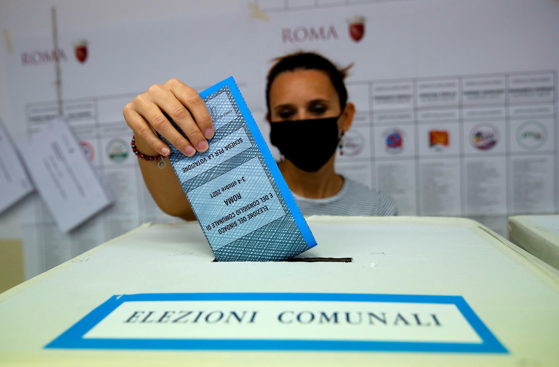2021-10-04T161241Z_1347050263_RC243Q96SNQ7_RTRMADP_3_ITALY-POLITICS-ELECTIONS