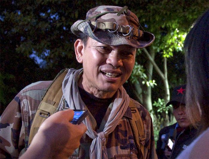 Thai Major-General Khattiya Sawasdipol moments before he was shot while being interviewed