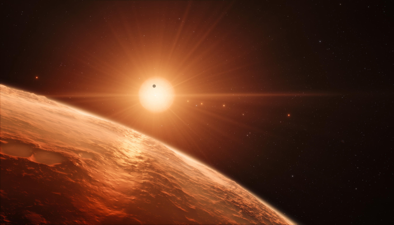 Vue d'artiste de ce à quoi pourrait ressembler la surface d'une des planètes du système Trappist-1, découvert par des astronomes belges.