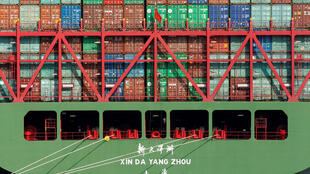 China Shipping containers sit on a ship in the Port of Los Angeles after being imported to the U.S., California, October 7, 2010.