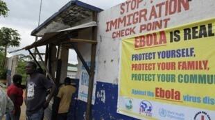 Wani Allon sanarwa akan Cutar Ebola da Jami'an shige da fice suka kafa a kasar Liberia domin tantance mutane