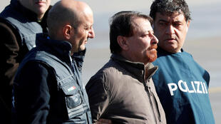 Former left-wing activist Cesare Battisti is escorted by Italian police after his arrival in Rome, 14 January 2019.