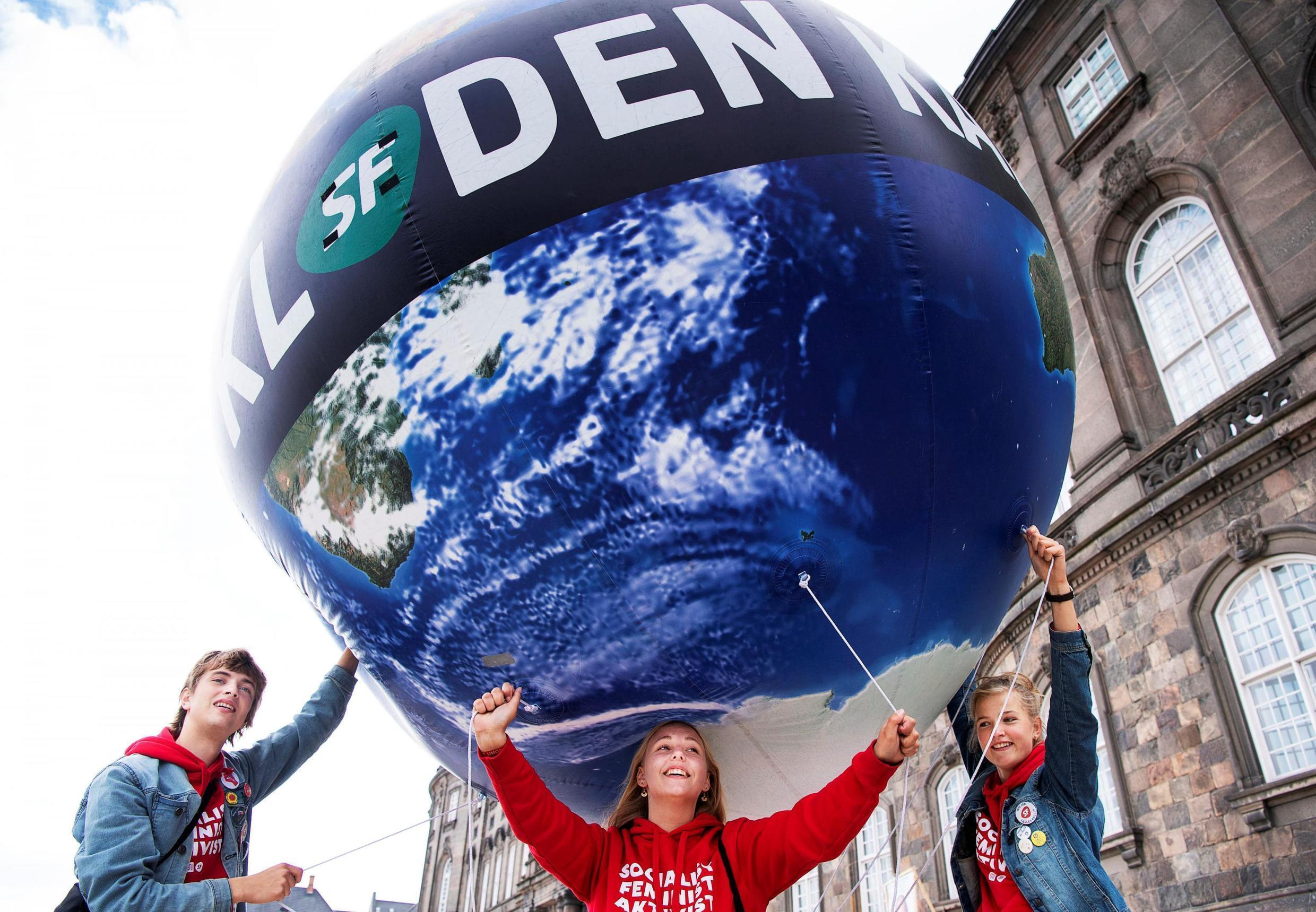 People attend the People's Climate March (Folkets Klimamarch) in front of Christiansborg Palace in Copenhagen, Denmark May 25, 2019.