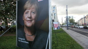 Posters of Angela Merkel's CDU and the hard-left Die Linke in Offenbach