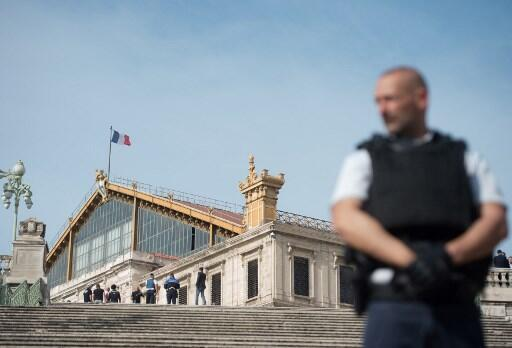 A French police officer stands outside Saint-Charles train station in Marseille on October 1, 2017, after a man armed with a knife killed two people before being shot by soldiers patrolling the area.