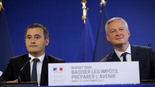 Le ministre de l'Économie et des Finances Bruno Le Maire (d) et celui de l'Action et des Comptes publics Gérald Darmanin, le 26 septembre 2019 à Paris.