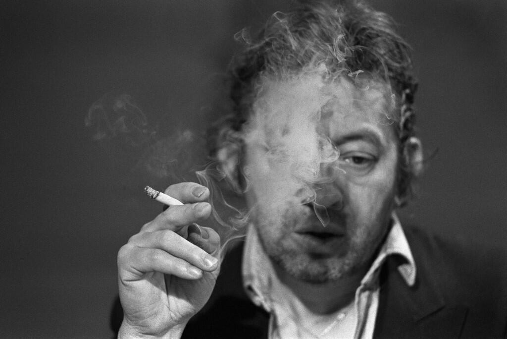 (FILES) A file photo taken on March 11, 1984 shows French singer-songwriter Serge Gainsbourg smoking during the 7 sur 7 tv show at the Studio Cognacq-Jay in Paris. - March 2, 2021 will mark the 30th anniversary of Serge Gainsbourg's death.