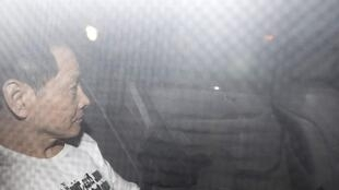 """圖為澳門黑道猛人綽號""""崩牙駒""""的尹國駒(Wan Kuok-koi)2012年12月1日出獄情景"""