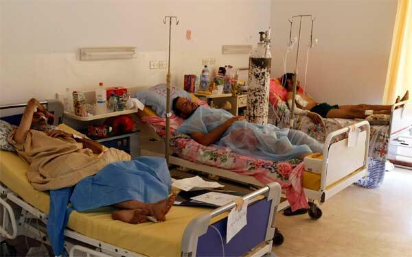 Rebel fighters, who were injured during fighting at Bab al-Aziziya, rest at Maitika Hospital in Tripoli August 27, 2011.