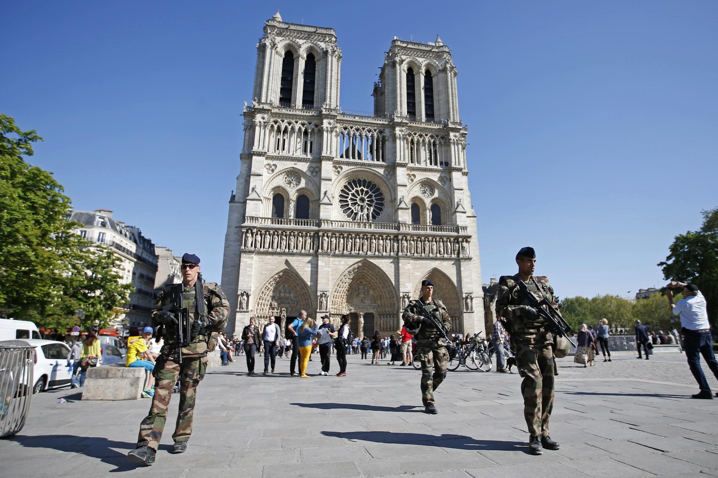 French soldiers patrol outside the Notre Dame Cathedral in Paris