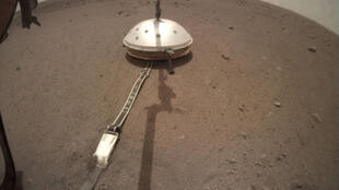 NASA's InSight lander deployed the seismometer on the Martian surface in December 2018. The seismometer is covered by the Wind and Thermal Shield.