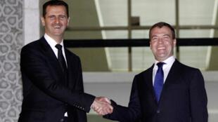 Russian Prime Minister Dmitry Medvedev with Syrian President Bashar al-Assad