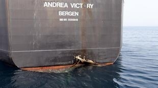 A damaged Andrea Victory ship is seen off the Port of Fujairah, United Arab Emirates, 13 May, 2019.