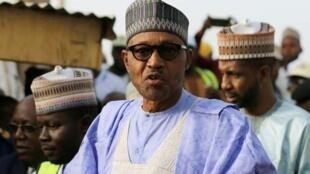 File photo of Nigerian President Muhammadu Buhari on 23 February in Daura, Katsina state, Nigeria.