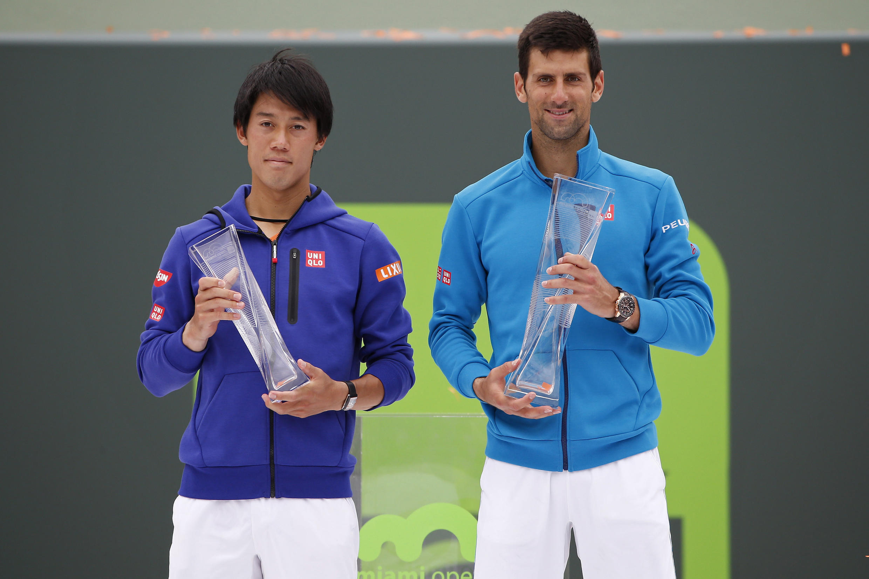Novak Djokovic (right) beat Kei Nishikori in straight sets to win the Miami Open for the sixth time.