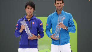 Novak Djokovic (right) beat Kei Nishikori in straight sets to win the Miami Open for the sixth time.