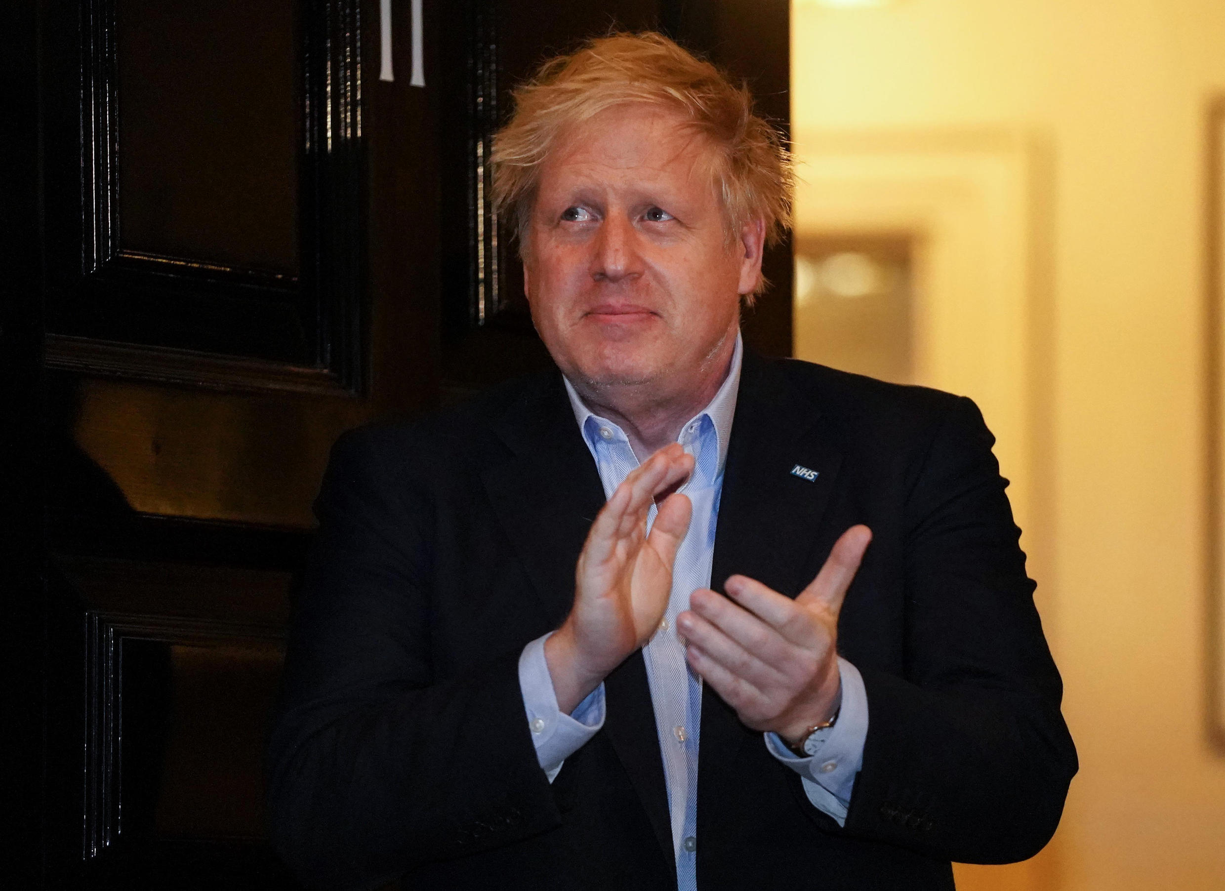 """Before being hospitalised Boris Johnson took part in a national """"clap for carers"""" to show thanks for the health workers battling the coronavirus pandemic"""