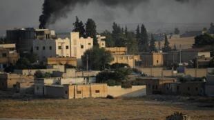 靠近土耳其边境叙利亚一侧小镇硝烟弥漫
