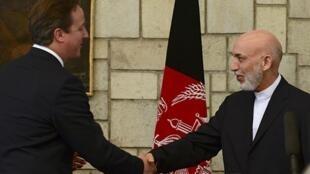 Премьер-министр Великобритании Дэвид Кэмерон, президент Афганистана Хамид Карзай. 29 июня 2013 год