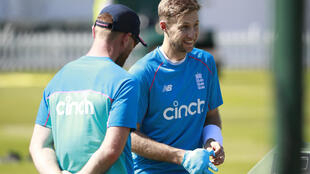 Blow - England captain Joe Root (R) reacts following some temporary repairs to a hand injury after being struck while batting in the nets at Lord's on Monday
