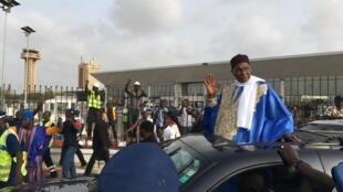 Rais wa zamani Abdoulaye Wade akiwasili jijini Dakar baada ya kuondoka nchini Ufaransa.