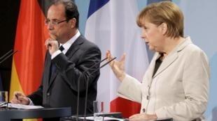 Le président français François Hollande et la chancelière Angela Merkel, à Berlin, le 15 mai 2012.