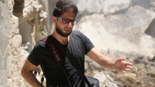 Le reporter, photographe et journaliste de l'AFP, Karam Al-Masri, à Alep en Syrie.