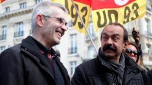 Líderes sindicais da CGT, Philippe Martinez e da FO, Yves Veyrier, na manifestação de hoje contra política social do governo de Macron