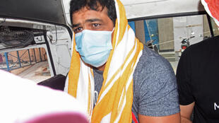 India's Olympic wrestling medallist Sushil Kumar sits inside a vehicle in Delhi after his arrest