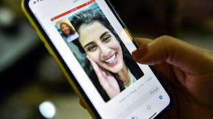 A tweet posted by the sister of Saudi activist Loujain al-Hathloul, Lina, shows a screenshot of the two of them conducting a video call following Hathloul's release after nearly three years in detention