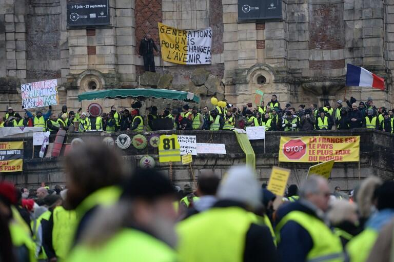 Yellow Vests gather during an anti-government demonstration called by the Yellow Vest movement, in Bourges, on January 12, 2019.