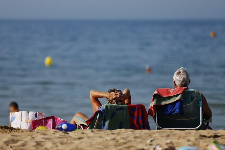 Sunbathing in People Colleville-Montgomery, north-western France, on Friday