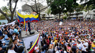Supporters of Juan Guaido at a meeting in Caracas, 19 April 2019.