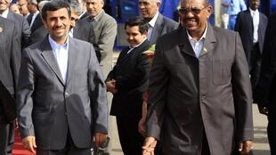 President Mahmoud Ahmadinejad and President Omar Hassan al-Bashir after talks focused on ties between their countries