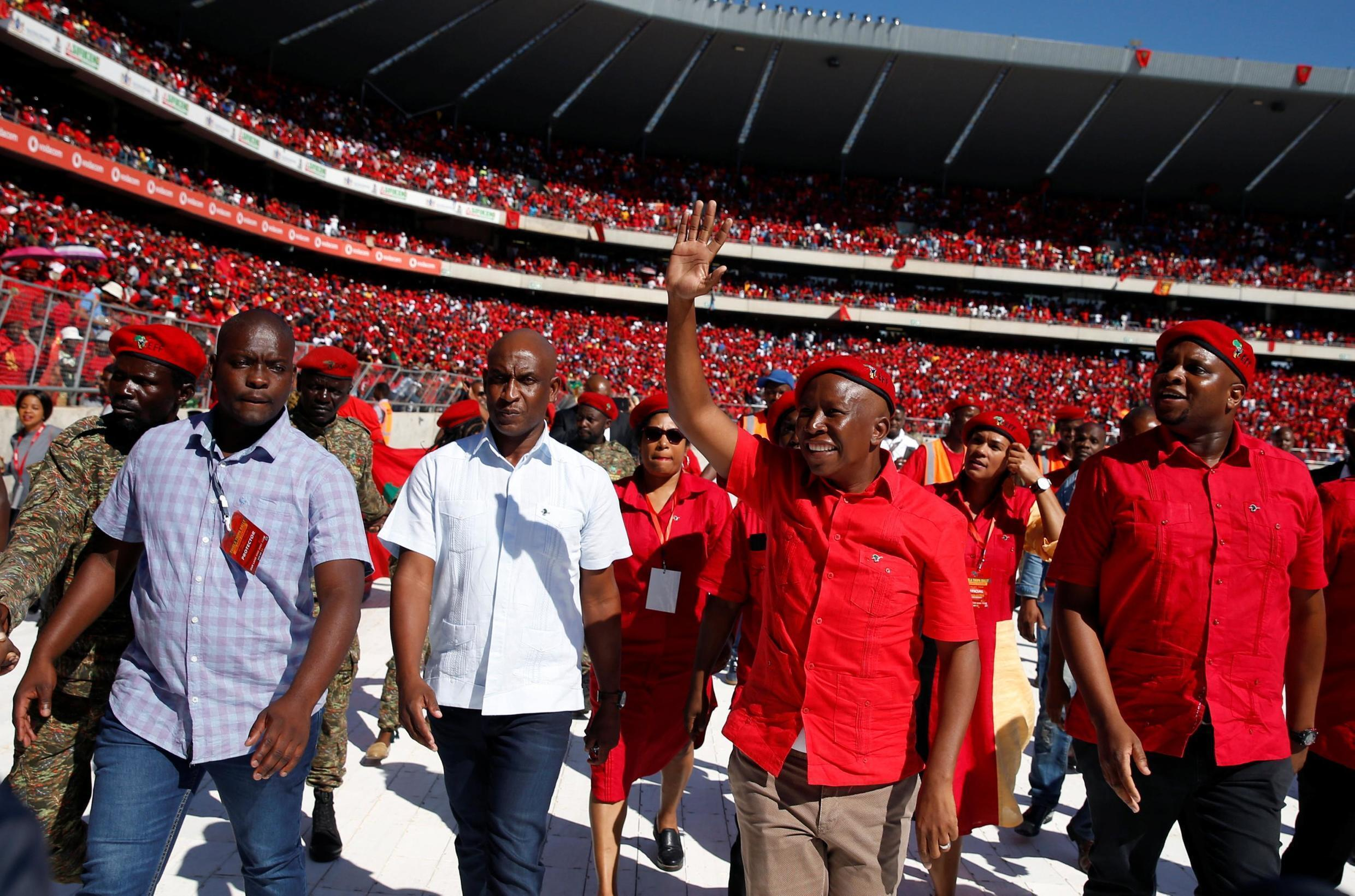 Julius Malema, leader of the Economic Freedom Fighters, greets supporters at a rally in Soweto, 5 May 2019.