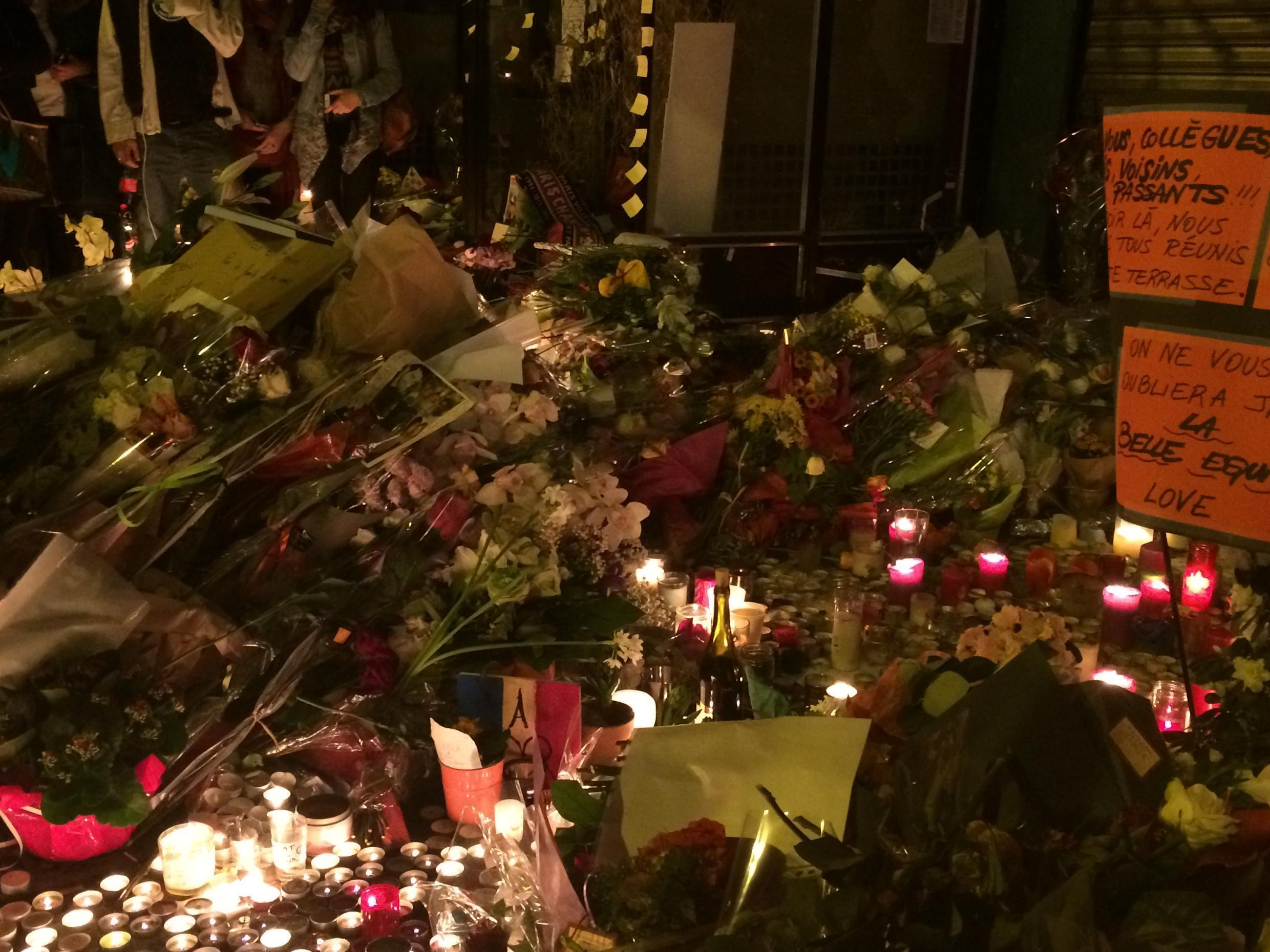 Flowers and candles outside the Belle Equipe.