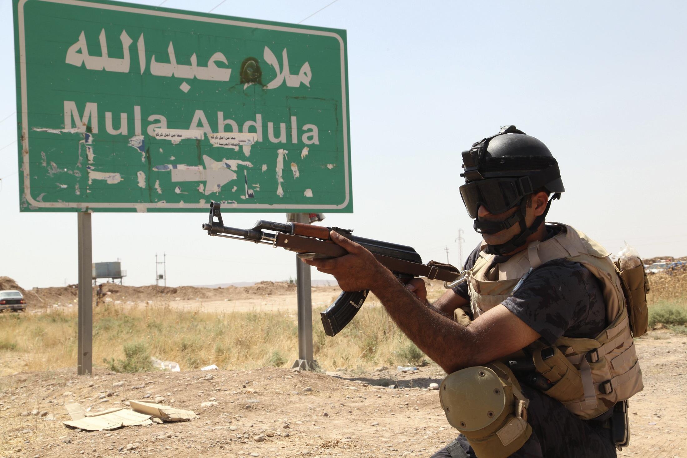 Patrouille des forces de sécurité kurdes dans la banlieue de Kirkouk, le 14 Juin 2014.