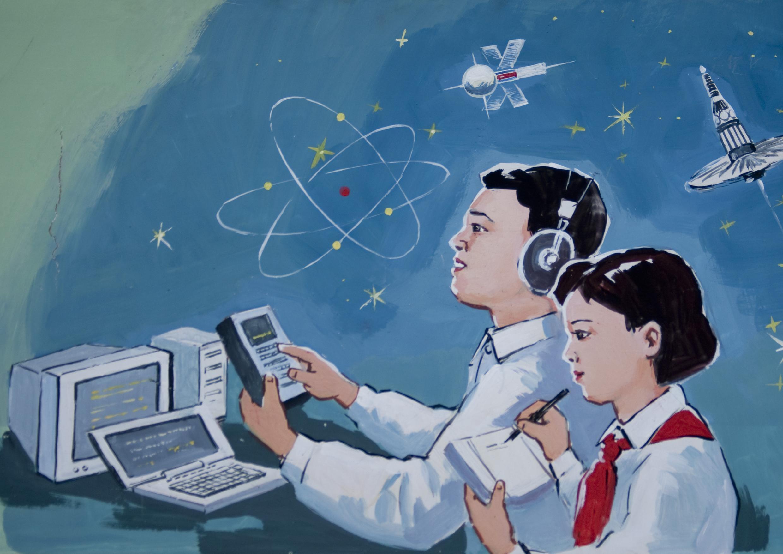 Poster dans une école de Pyongyang vantant l'accès aux nouvelles technologies pour les écoliers.