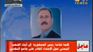 President Ali Abdallah Saleh's picture on TV screens as his audio message is broadcast