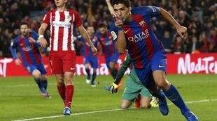 Barcelona striker Luis Suarez celebrates after scoring a goal against Atletico Madrid on Tuesday.