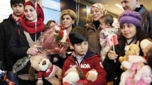 La famille d'Aylan Kurdi enfin réunie à Vancouver.