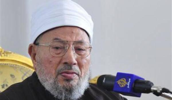 មេផ្សព្វផ្សាយសាសនាអ៊ីស្លាមជ្រុុលនិយម និងហិង្សាឈ្មោះ Jusuf Al-Qaradawi ជាមួយនឹងក្បាលមីក្រូរបស់ ទូរទស្សន៍ Al-Jazeera
