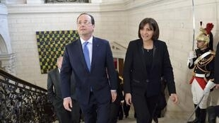 French President François Hollande with Paris Mayor Anne Hidalgo at a ceremony to mark the 70th anniversary of the granting of voting rights to French women