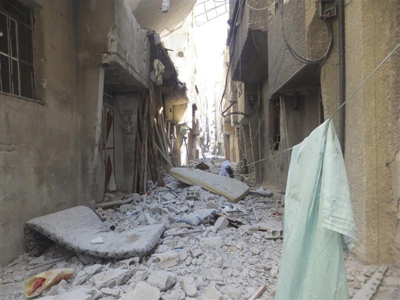 Bairro de Tadamon, em Damasco, vizinho do campo de refugiados palestinos de Yarmuk que foi bombardeado pelas forças sírias no domingo.