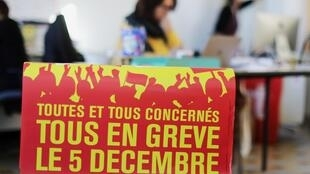 """A poster that reads """"All on strike on December 5"""" is pictured at the Bourse du Travail during preparations for the national strike against French government's pensions reform plans, in Nice, France, December 3, 2019"""