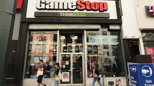 People pass a GameStop store in lower Manhattan on September 16, 2019 in New York City